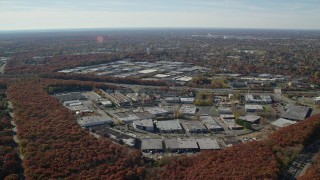 AX119_249 - 6K stock footage aerial video of office buildings in Autumn, Plainview, New York