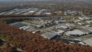 AX119_250 - 6K stock footage aerial video of office and apartment buildings in Autumn, Plainview, New York