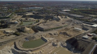 AX119_253 - 6K stock footage aerial video of orbiting a construction site in Autumn, Melville, New York