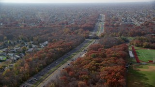 AX120_003 - 6K stock footage aerial video of a freeway in Autumn, Farmingdale, New York