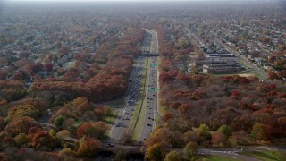 AX120_004 - 6K stock footage aerial video of flying over a freeway in Autumn, Massapequa, New York