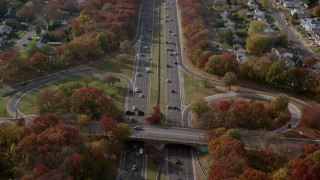 AX120_005 - 6K stock footage aerial video fly over light traffic on a freeway in Autumn, Massapequa, New York