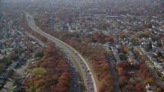 AX120_006 - 6K stock footage aerial video of a freeway and suburban homes in Autumn, Massapequa, New York