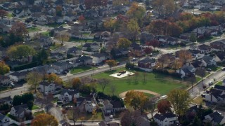 AX120_007 - 6K stock footage aerial video of suburban neighborhoods in Autumn, Massapequa, New York