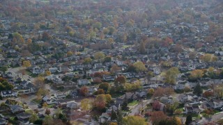 AX120_008 - 6K stock footage aerial video of suburban neighborhoods in Autumn, Massapequa, New York