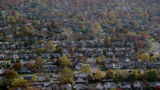 AX120_009 - 6K stock footage aerial video of circling suburban neighborhoods in Autumn, Massapequa, New York