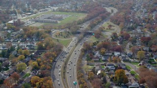 AX120_018 - 6K stock footage aerial video of a view of light traffic on a freeway in Autumn, North Bellmore, New York