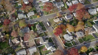 AX120_021 - 6K stock footage aerial video of a school bus in a quiet suburban neighborhood in Autumn, North Bellmore, New York