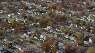 AX120_027 - 6K stock footage aerial video of blocks of suburban homes in Autumn, Hempstead, New York