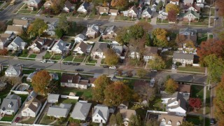 AX120_028 - 6K stock footage aerial video of an orbit of suburban homes in Autumn, Hempstead, New York