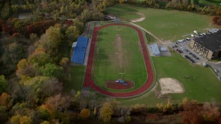 AX120_030 - 6K stock footage aerial video of a high school football field in Autumn, Hempstead, New York