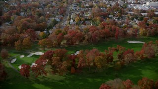 AX120_031 - 6K stock footage aerial video fly over golf course and suburbs in Autumn, West Hempstead, New York