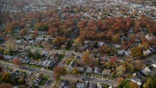 AX120_033 - 6K stock footage aerial video of quiet suburban neighborhoods in Autumn, West Hempstead, New York