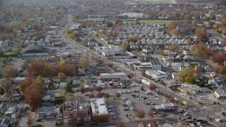 AX120_035 - 6K stock footage aerial video of suburbs and stores along a busy street in Autumn, Elmont, New York
