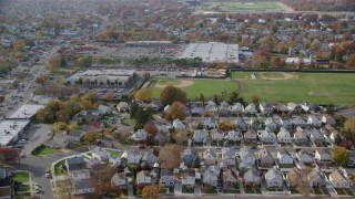 AX120_036 - 6K stock footage aerial video of homes, school baseball fields and store in Autumn, Elmont, New York