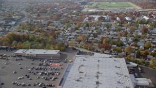 AX120_037 - 6K stock footage aerial video of a large store and suburban homes in Autumn, Elmont, New York