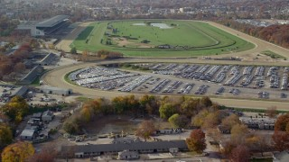 AX120_038 - 6K stock footage aerial video of a horse-racing track in Autumn, Elmont, New York
