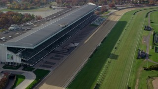 AX120_039 - 6K stock footage aerial video of stands at a horse-racing track in Autumn, Elmont, New York