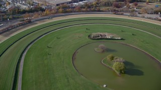 AX120_040 - 6K stock footage aerial video of flying over a horse-racing track in Autumn, Elmont, New York