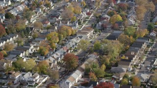 AX120_042 - 6K stock footage aerial video orbit suburban tract homes in Autumn, Queens Village, Queens, New York City