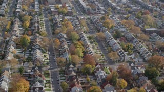 AX120_043 - 6K stock footage aerial video of orbiting suburban tract homes in Autumn, Queens Village, Queens, New York City