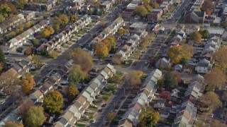 AX120_043E - 6K stock footage aerial video of orbiting suburban tract homes in Autumn, Queens Village, Queens, New York City