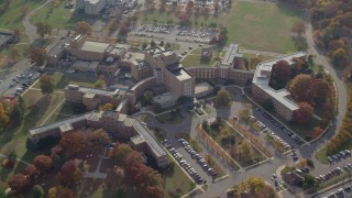 AX120_045E - 6K stock footage aerial video approach a hospital in Autumn, Jamaica, Queens, New York City