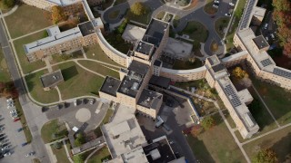 AX120_047 - 6K stock footage aerial video of flying away from a hospital in Autumn, Jamaica, Queens, New York City