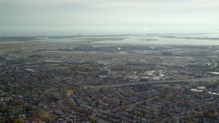 AX120_048 - 6K stock footage aerial video of approaching John F. Kennedy International Airport in Autumn, Queens, New York