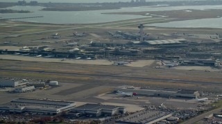AX120_049 - 6K stock footage aerial video of John F. Kennedy International Airport in Autumn, in New York