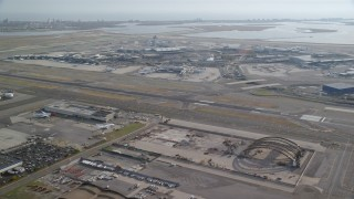 AX120_051 - 6K stock footage aerial video of John F. Kennedy International Airport in Autumn