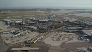 AX120_052E - 6K stock footage aerial video orbit John F. Kennedy International Airport, New York in Autumn