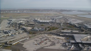 AX120_053 - 6K stock footage aerial video of an orbit of John F. Kennedy International Airport in Autumn