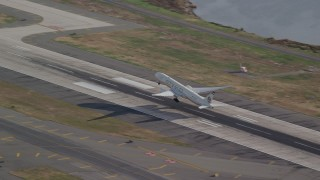 AX120_056 - 6K stock footage aerial video of an airliner taking off from JFK Airport, New York