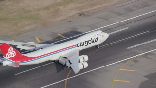 AX120_063 - 6K stock footage aerial video of a cargo plane slowing down on runway at JFK Airport, New York