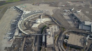 AX120_064 - 6K stock footage aerial video fly over terminals at John F Kennedy International Airport, New York