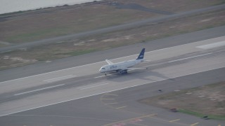 AX120_066 - 6K stock footage aerial video track a commercial jet taking off from JFK Airport, New York