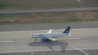 AX120_066E - 6K stock footage aerial video track a commercial jet taking off from JFK Airport, New York