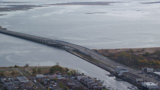 AX120_072 - 6K stock footage aerial video of a small bridge spanning a bay in Autumn, Jamaica, New York