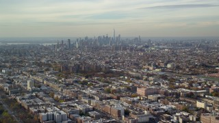 AX120_080 - 6K stock footage aerial video of Lower Manhattan skyline seen from Brooklyn in Autumn, New York City