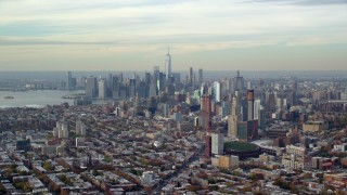 AX120_084 - 6K stock footage aerial video of Downtown Brooklyn and Lower Manhattan skylines in Autumn, New York City