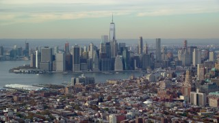 AX120_086 - 6K stock footage aerial video of the towering Lower Manhattan skyline seen from Brooklyn in Autumn, New York City