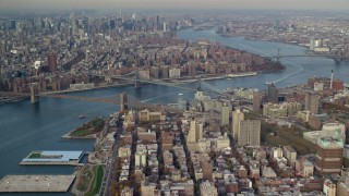 AX120_091 - 6K stock footage aerial video of Brooklyn and Manhattan Bridges in Autumn, New York City