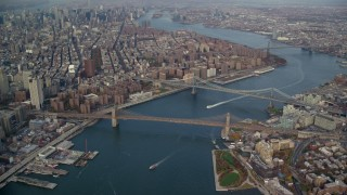 AX120_094 - 6K stock footage aerial video of a view of the Brooklyn and Manhattan Bridges in Autumn, New York City
