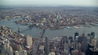 AX120_105 - 6K stock footage aerial video of the Brooklyn Bridge, Manhattan Bridge and Brooklyn skyscrapers, New York City