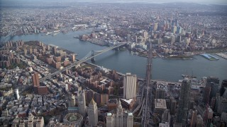 AX120_112 - 6K stock footage aerial video of a wide view of the Brooklyn Bridge and Manhattan Bridge in New York City