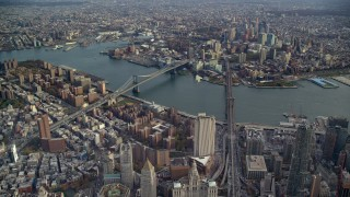 AX120_112E - 6K stock footage aerial video of a wide view of the Brooklyn Bridge and Manhattan Bridge in New York City