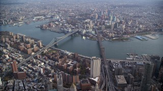 AX120_113 - 6K stock footage aerial video of an approach to the Brooklyn Bridge and Manhattan Bridge in New York City