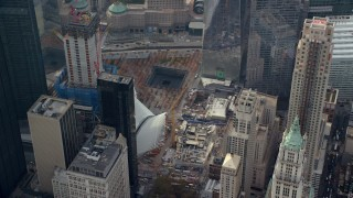 AX120_115 - 6K stock footage aerial video orbit World Trade Center Memorial in Lower Manhattan, New York City