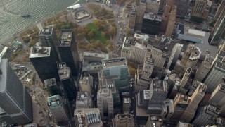 AX120_117E - 6K stock footage aerial video bird's eye of skyscrapers, reveal Battery Park in Lower Manhattan, New York City